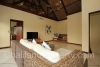 Upstairs fourth bedroom/TV room with shared bathroom